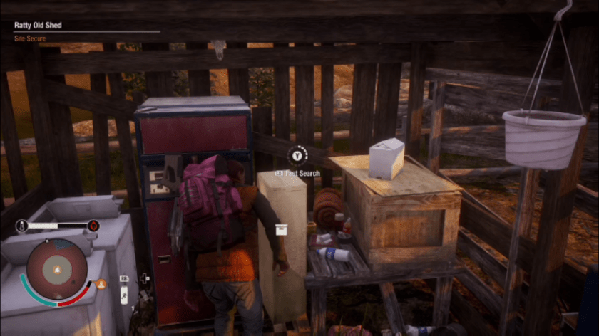 A survivor search's for loot in a junk pile.