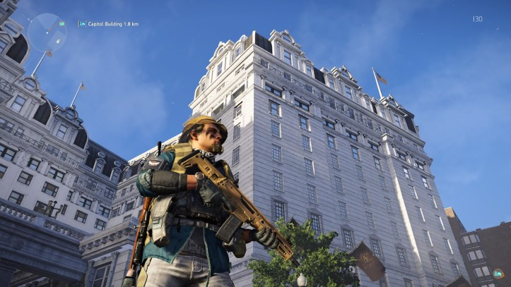 An agent stands in front of a tall building in The Division 2.