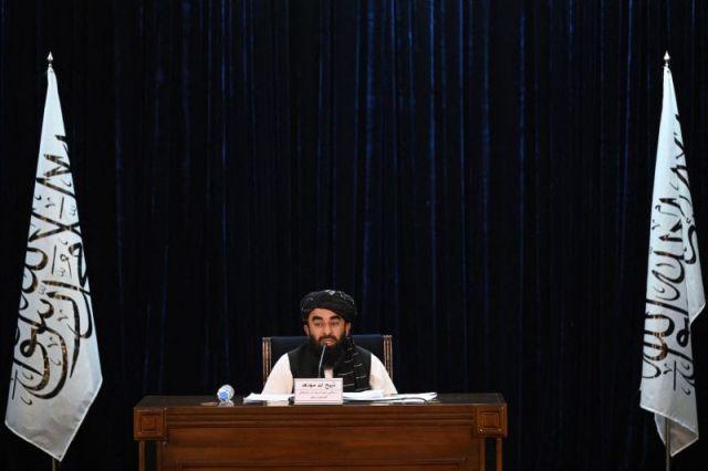 TOPSHOT - Taliban spokesman Zabihullah Mujahid addresses a press conference in Kabul on September 7, 2021.