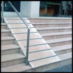 Ramp inclined in the angle of 60 degree, railing provided on one side and stairs beside the ramp