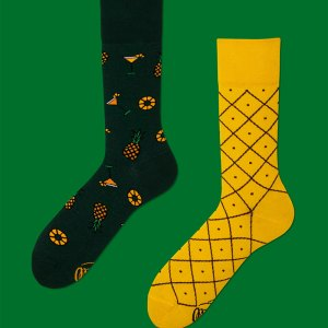Know someone that loves pina coladas? Well, these pineapple themed mismatched socks will be sure to keep your friend's feet warm and cozy if they decide to go dancing in the rain - or just spend a whimsical night in. pineapple socks dress socks men's fashion gifts for him