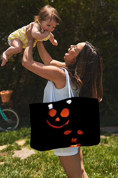 Halloween black and orange lit pumpkins tote bag