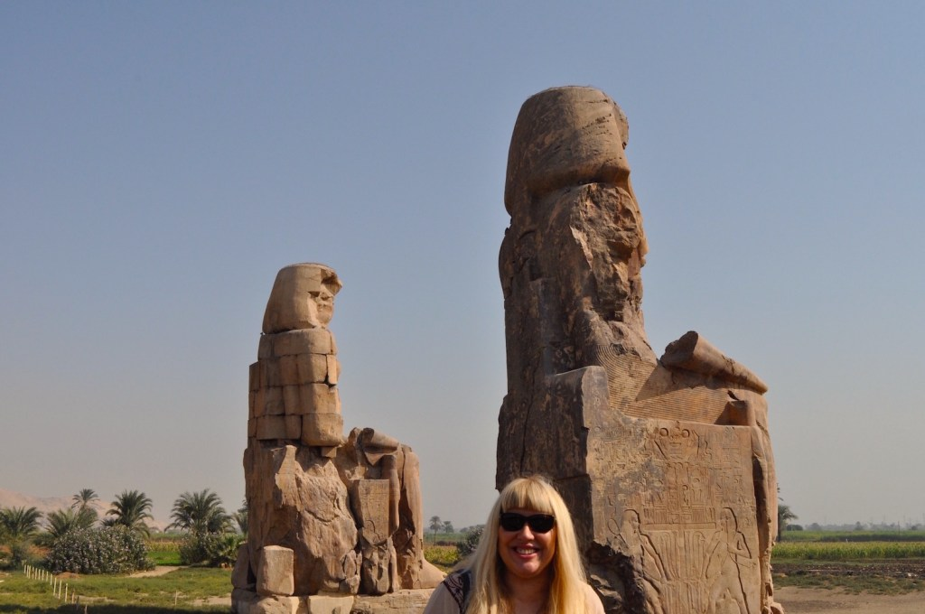 Sema Tawy on Colossus of Memnon throne by Antoine Gigal