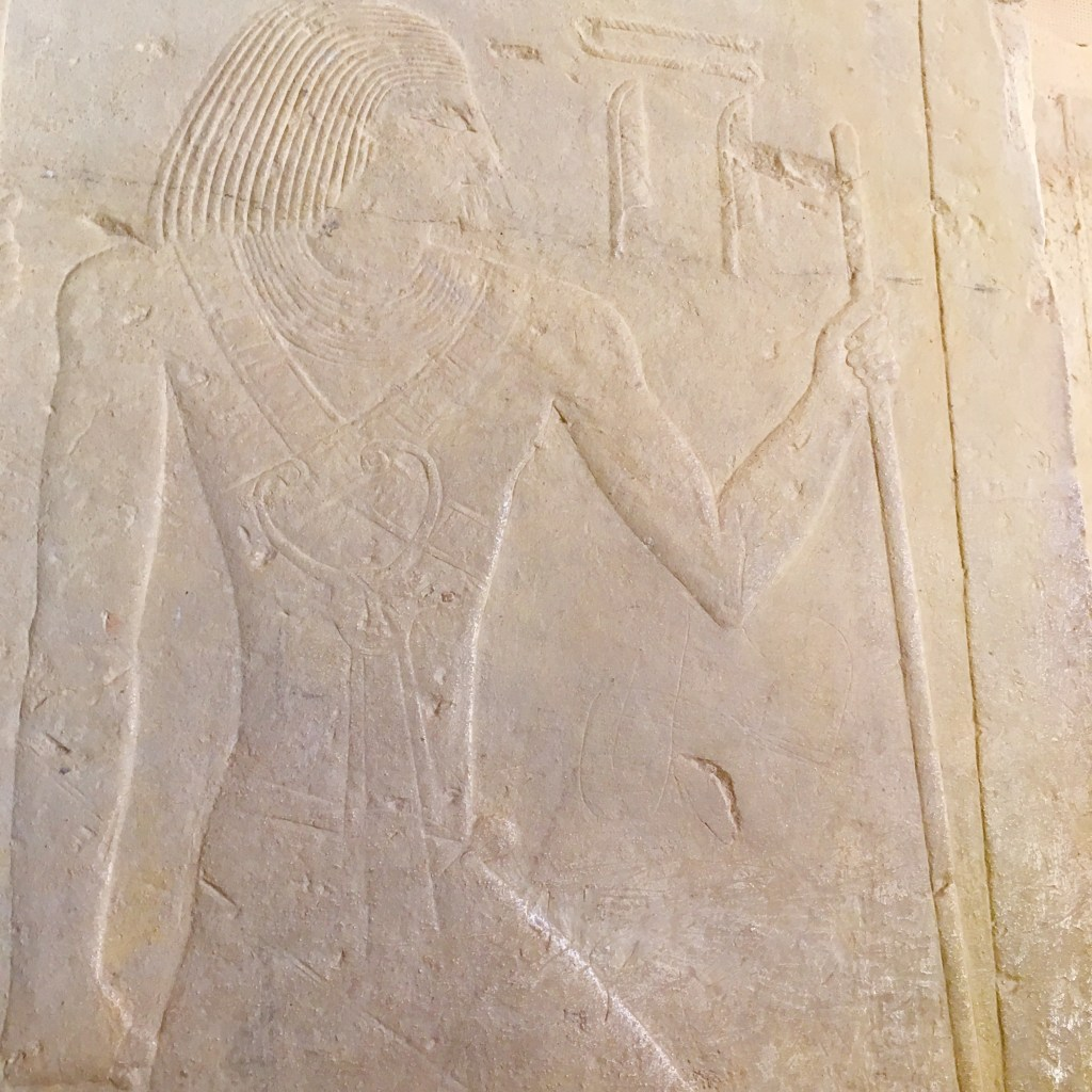 Ti Master of secret words wearing rare collar of goddess Bat representing feminine power in his mastaba in Sakkara by Gigal