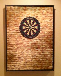 protect-your-wall-from-stray-darts-with-diy-dartboard-cabinet-made-wine-corks.w654