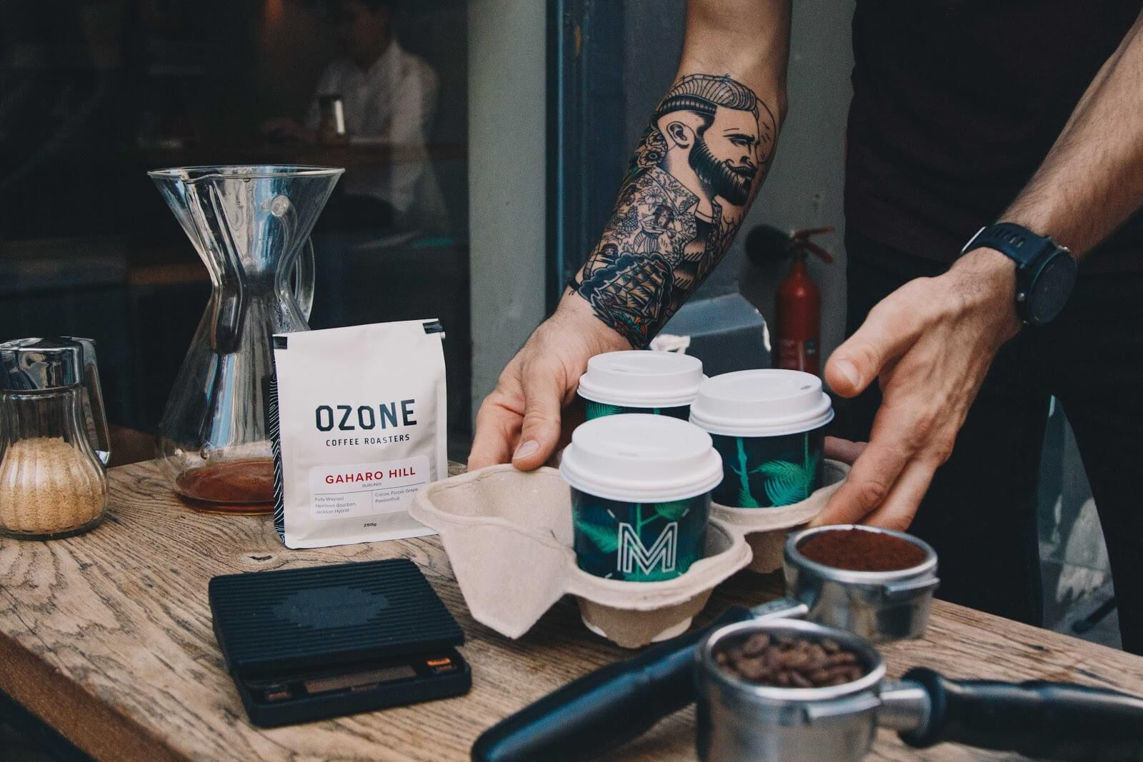 man delivering coffee postmates driver requirements