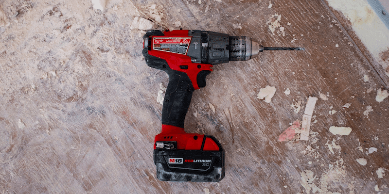 Gig economy: Power drill sitting on piece of wood
