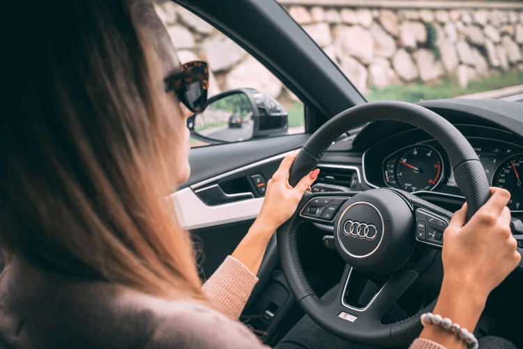 Uber Black: a woman drives a car with a black interior