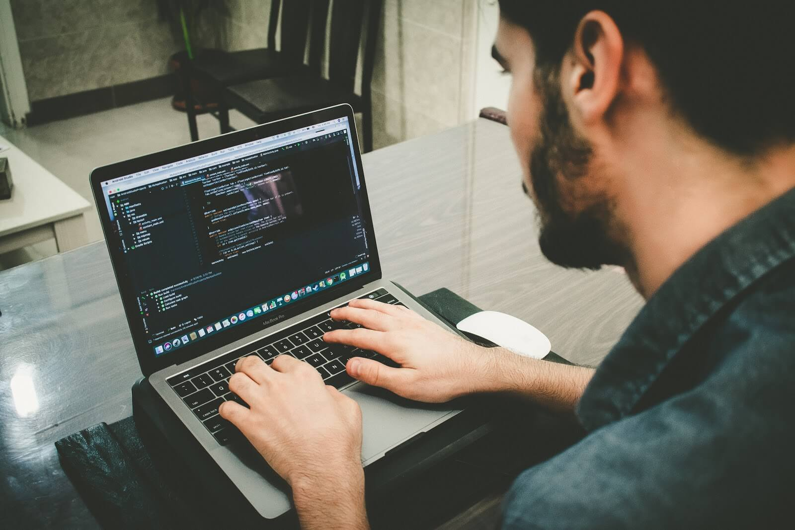 How to become a software developer: an over-the-shoulder view of a man coding
