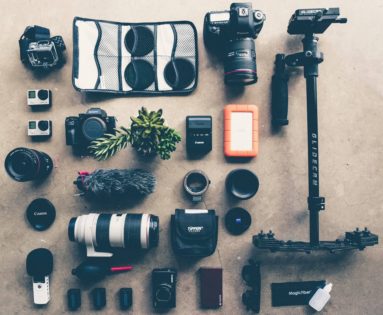 How to become a photographer: a lot of camera equipment laid out