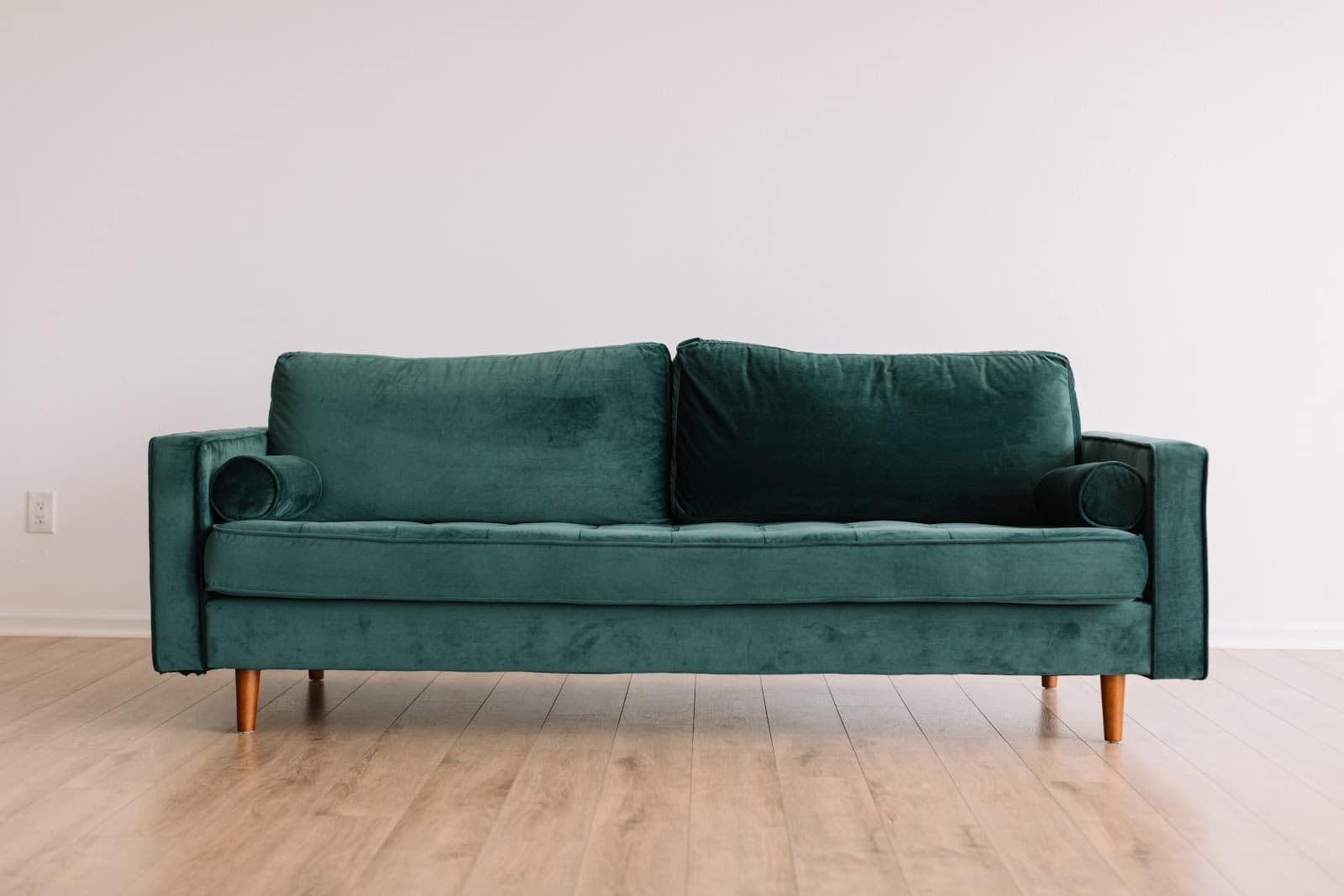 A velvet couch that could be sold on AptDeco