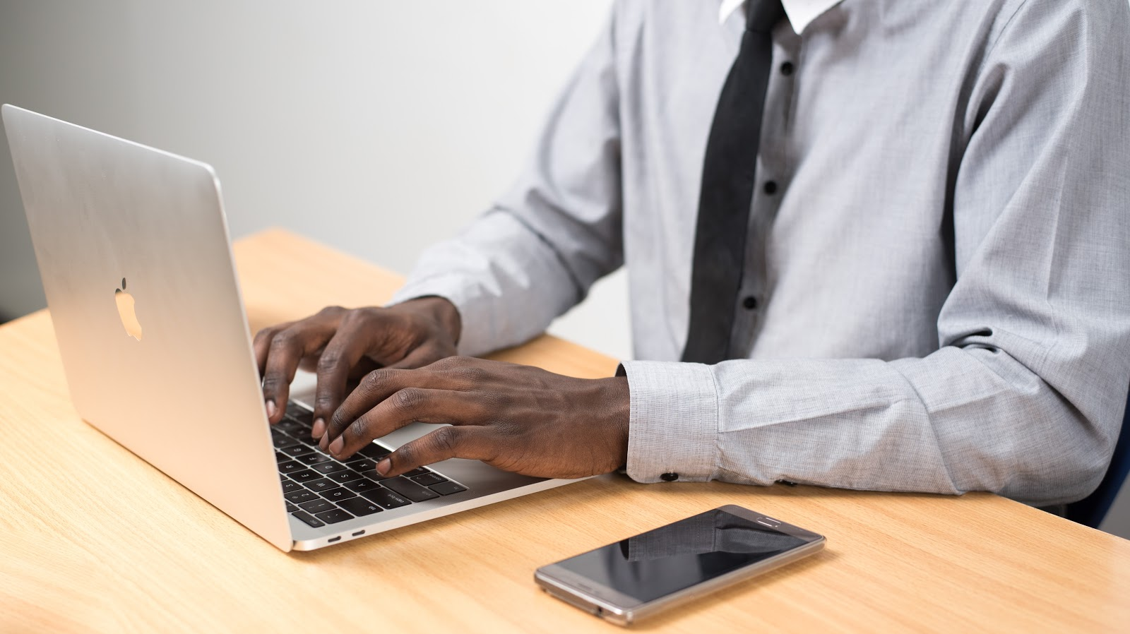 business entity: person typing on laptop computer