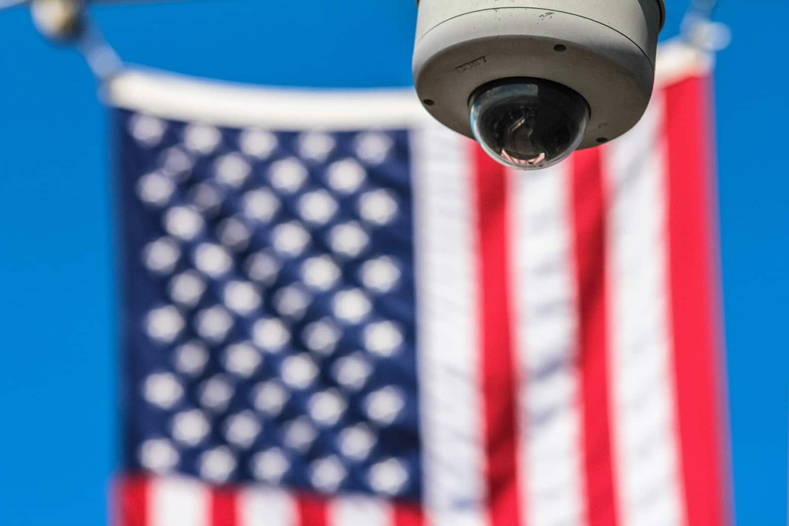 security camera in front of American flag