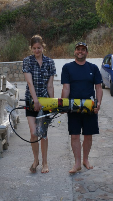 Dave and Alyssa carrying the electrode setup to the beach. Picture by Roy Price.