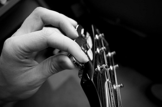Image result for hand tuning guitar