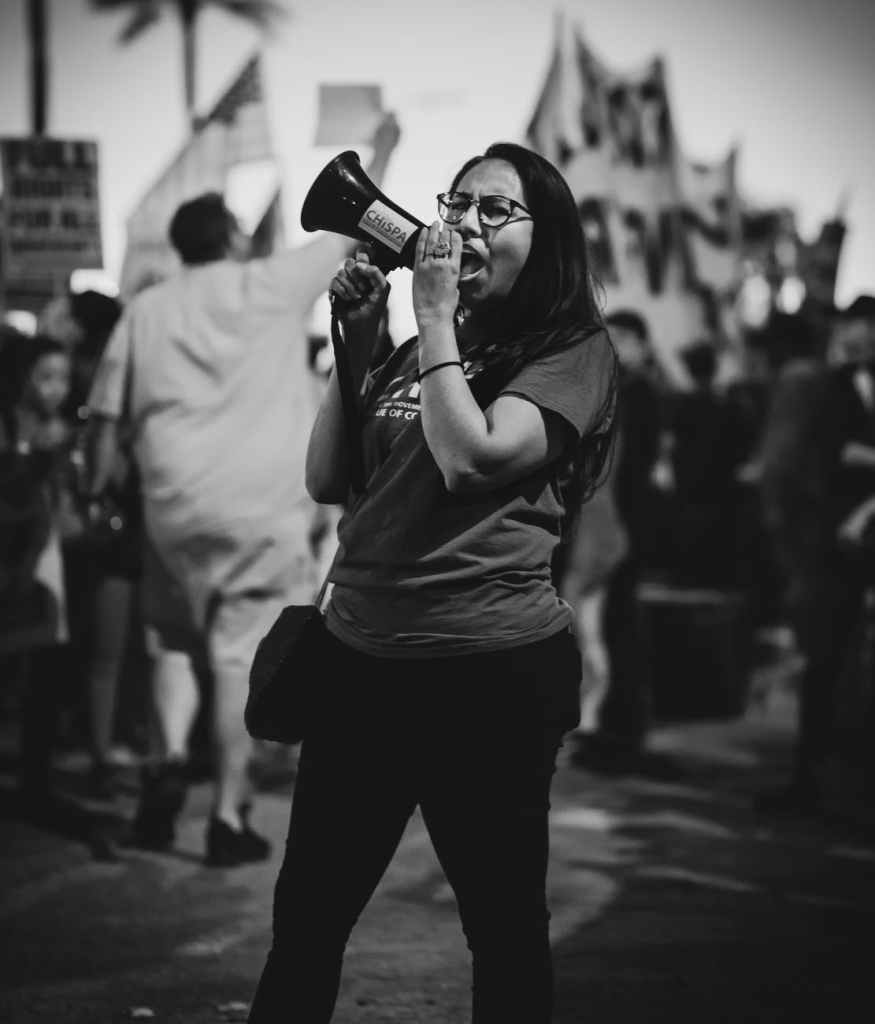 black female activist with loudspeaker on street