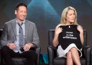 """PASADENA, CA - JANUARY 15: Actor David Duchovny (L) and actress Gillian Anderson speak during the FOX segment for the television show """"The X Files"""" at the Langham Hotel on January 15, 2016 in Pasadena, California. (Photo by Frederick M. Brown/Getty Images)"""