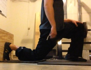 Properly maintaining my spinal position during lunge stretch