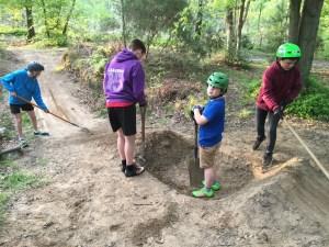 kids digging and raking