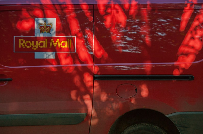 Royal Mail van with tree shadow