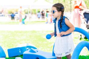 Girl playing with big blue blocks