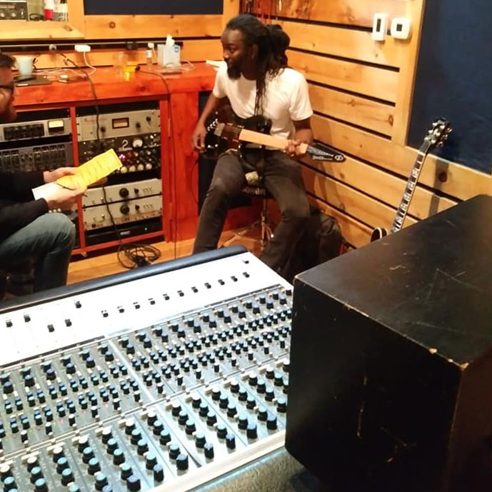 Amadou Gaye with a Gimenez Sinner at the mixing board