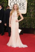 Rising star Amanda Seyfried looks a bit pale (but still magnificent) in Givenchy half-sheer gown.