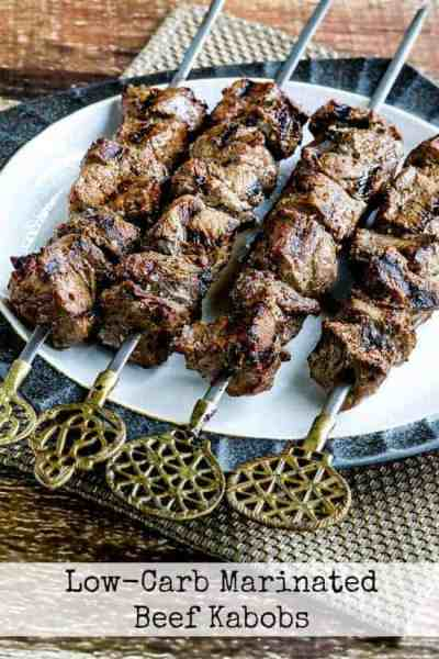 Beef kabobs on a white plate