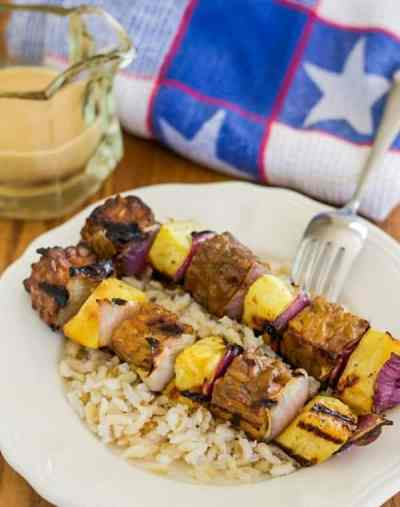 Tempeh pineapple kebabs and rice on plate