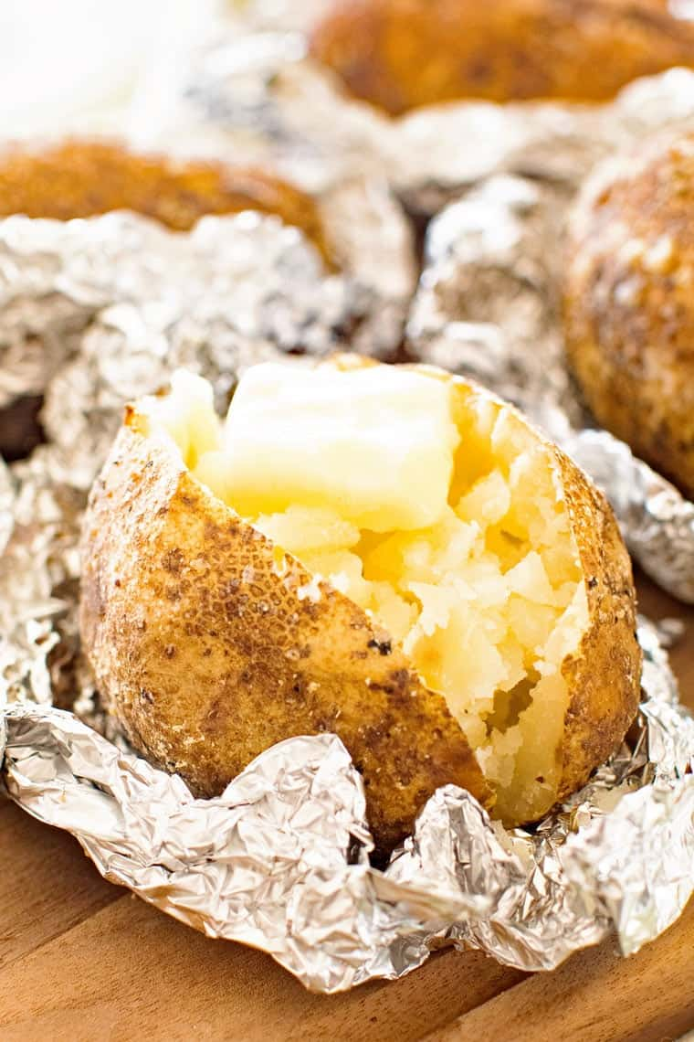 baked ptoatoes cut up with butter