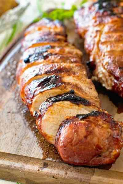 Grilled Asian Pork Loin pieces on cutting board