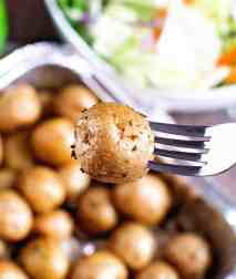 Seasoned potatoes on fork