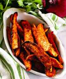 Seasoned sweet potato wedges in white bowl