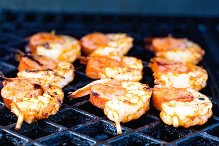 sausage and shrimp skewers on grill