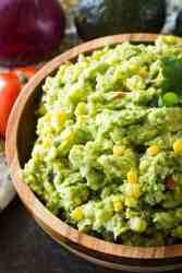 Corn guacamole in brown bowl