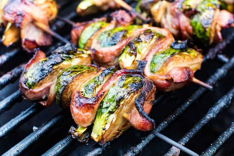 Grilled Brussels Sprouts on skewer laying on grill