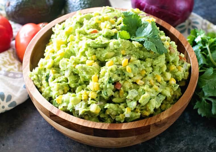 Grilled Corn Guacamole in brown bowl