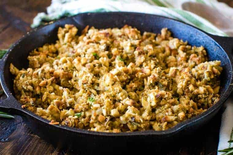 Landscape view of a cast iron skillet full of smoked stuffing