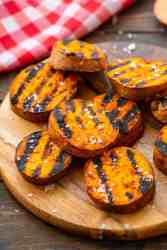 wood cutting board with Grilled-Sweet-Potatoes-Recipe
