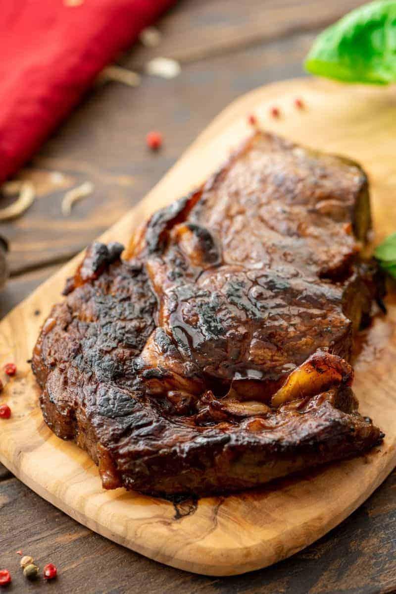 Steak prepared in marinade on wood platter
