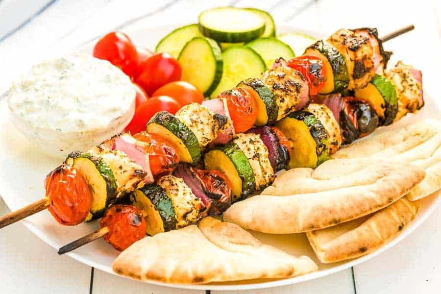 Greek Chicken Kabobs Recipe on plate with pita bread