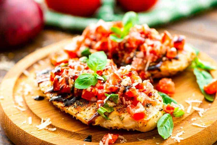 Grilled Bruschetta Chicken on cutting board