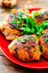 Grilled Chicken Thighs on red plate