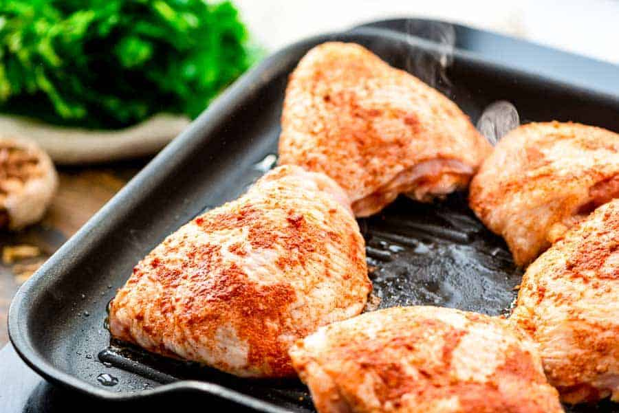Grill pan with bone-in chicken thighs