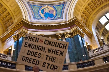 "Placard with the slogan ""When is enough enough, when does hte greed stop?"", Wisconsin State Capitol protest 2014"