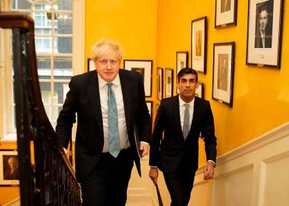 Boris Johnson and Rishi Sunak make their way up the staircase of No10 Downing Street