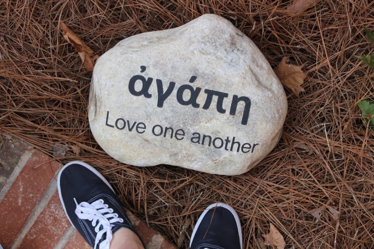 Love one another written in stone