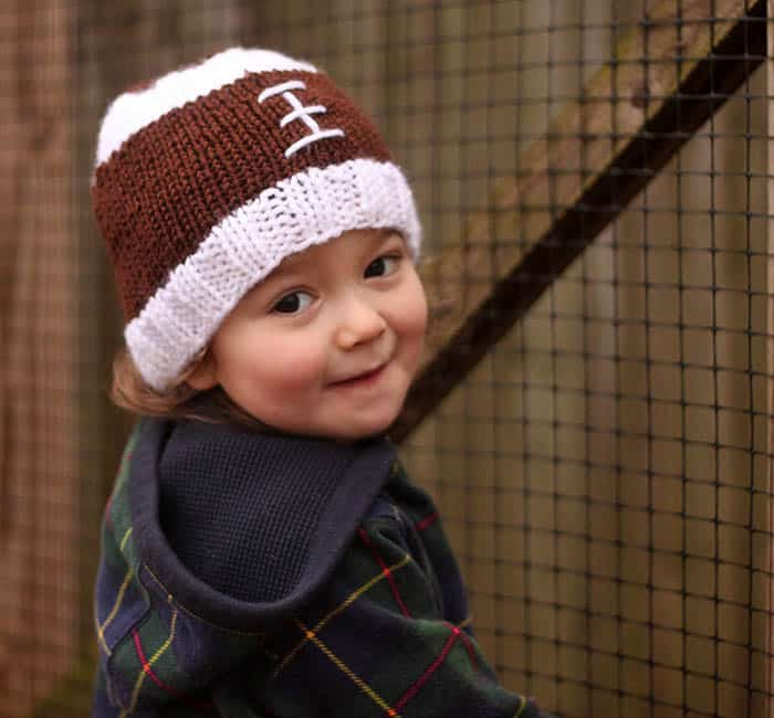 Football Baby Hat Free Knitting Pattern by blogger Gina Michele