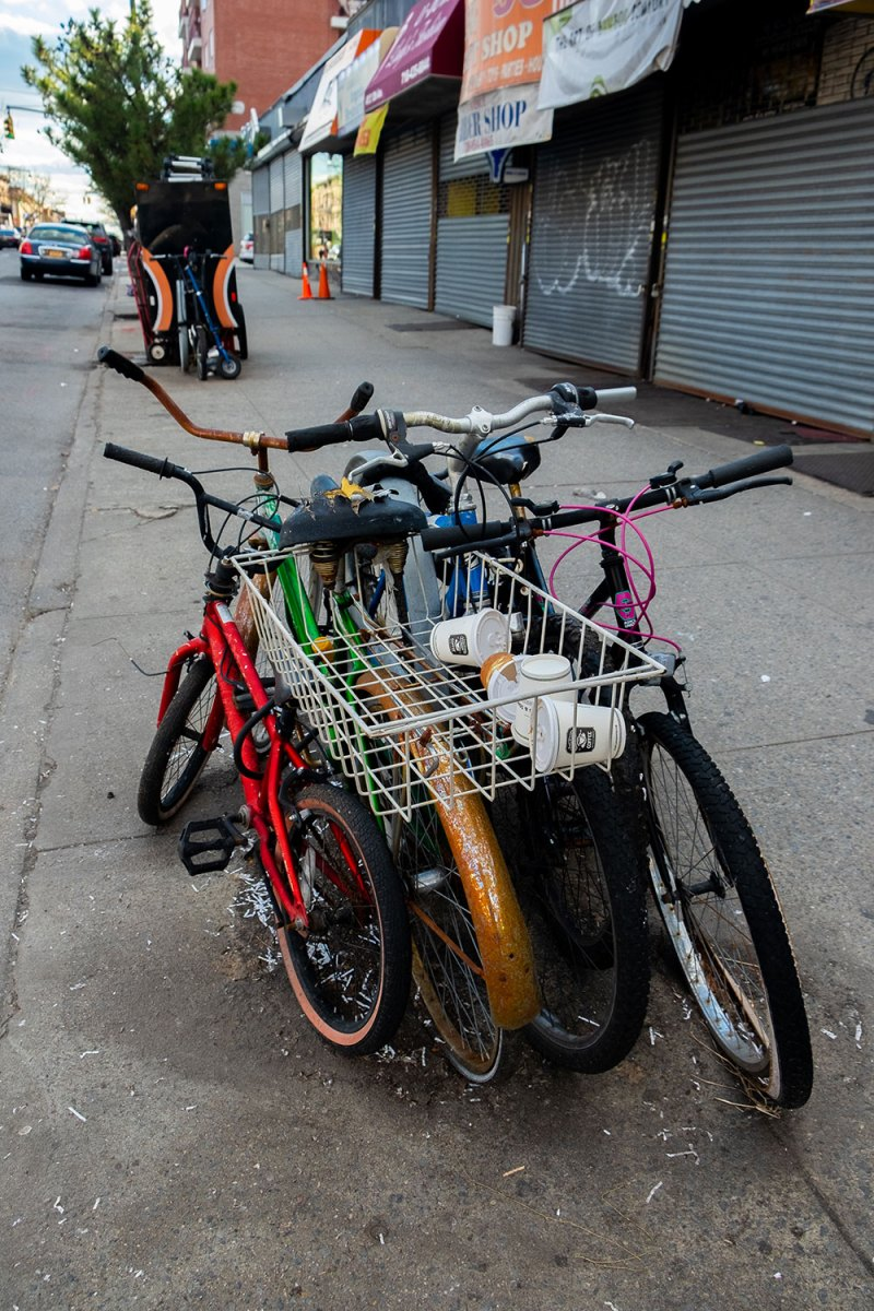 bicycles chained to a rack on a street in Brooklyn