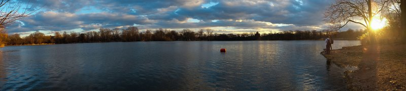 panorama of two kids fishing at Prospect Park